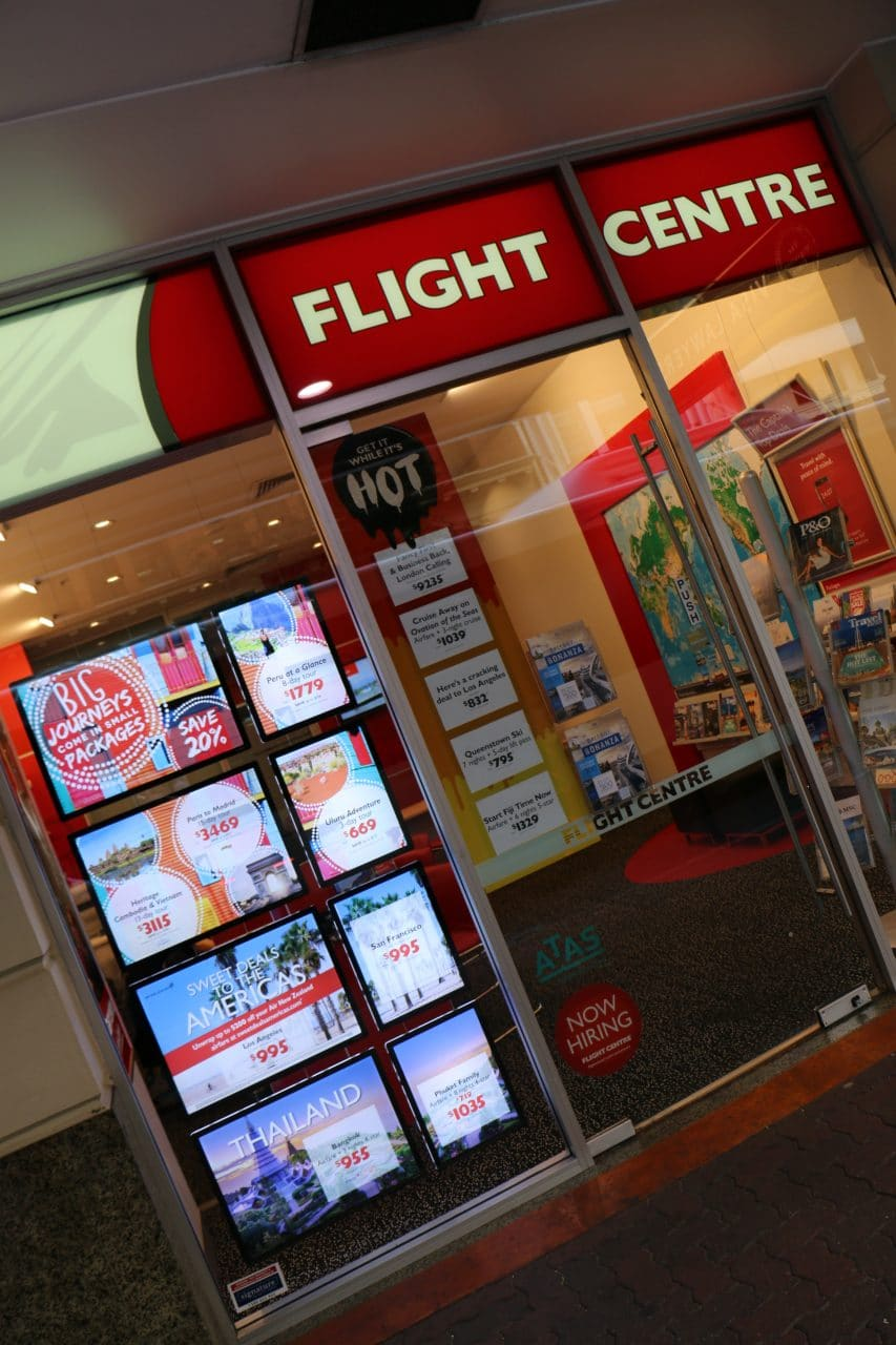 customer testimonial led display travel agency window